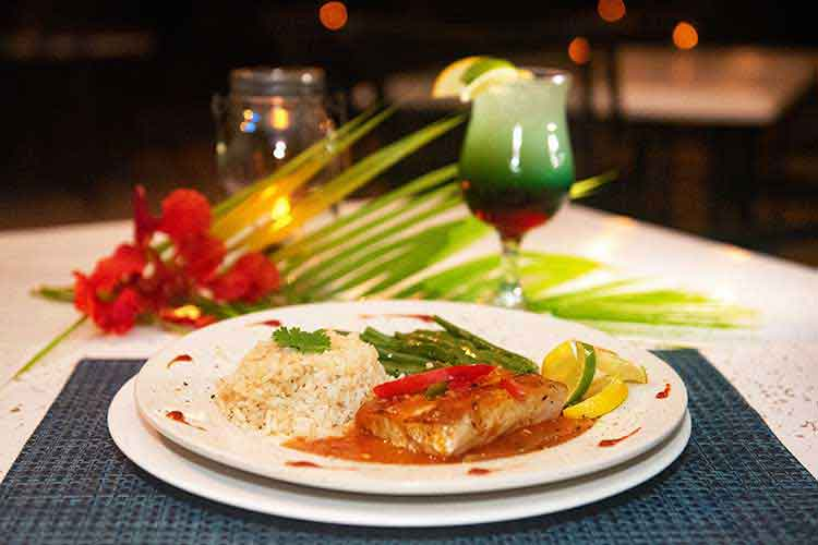 Grilled salmon with rice and green beans and a cocktail at Root 42 St. Thomas USVI