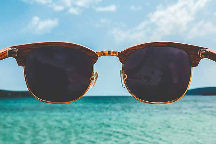 View of Caribbean ocean with brown sunglasses