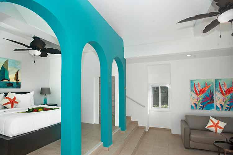 one bedroom suite at Flamboyan on the bay with turquoise wall