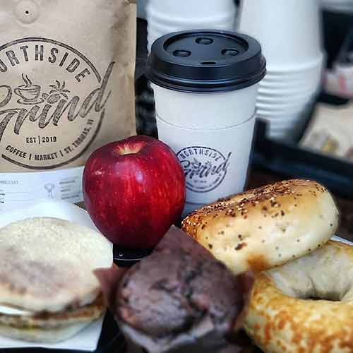 bagels muffins and sandwiches with to go coffee cup from Northside grind