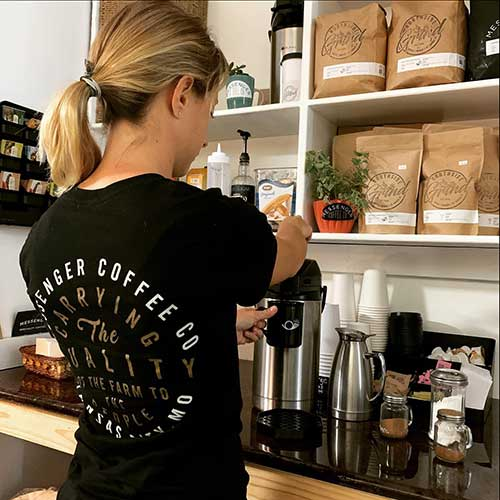 Trish Dahl, co-owner of Northside grind stocks the self-serve coffee station with sugar, cream honey, agave nectar, cinnamon, and nutmeg.