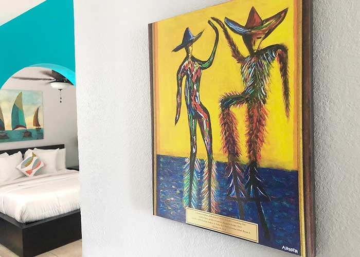 "A print of the original painting by Augustin Kelvin Holder, ""Jumbie Dem"" gifted to the BVI Premier by the U.S. Virgin Islands Governor, hangs in guest rooms throughout Flamboyan Resort."