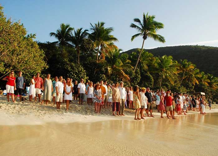 Photo courtesy of Yelena Rogers photo depicts annual group vow renewal ceremony at trunk bay USVI