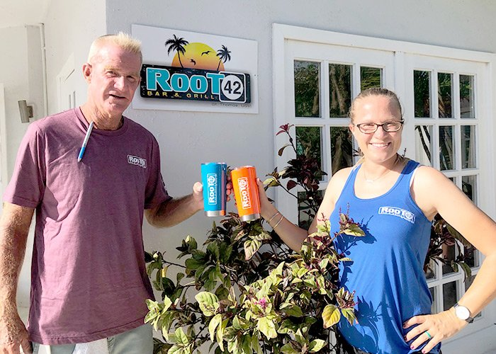 bartender and general manager of Root 42 hold up branded merchandise